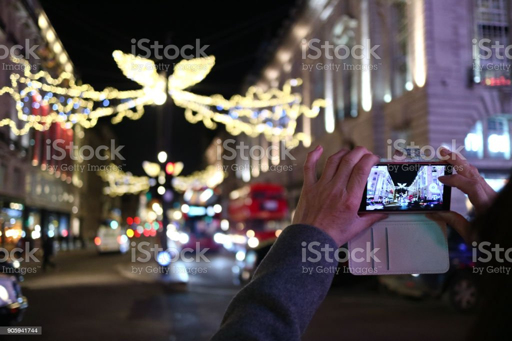 Someone taking a photo of the Christmas lights in London stock photo