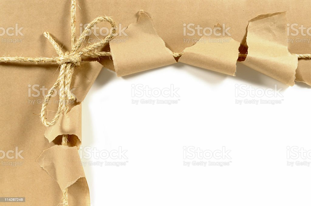Someone wants to know what's inside the torn brown parcel  stock photo