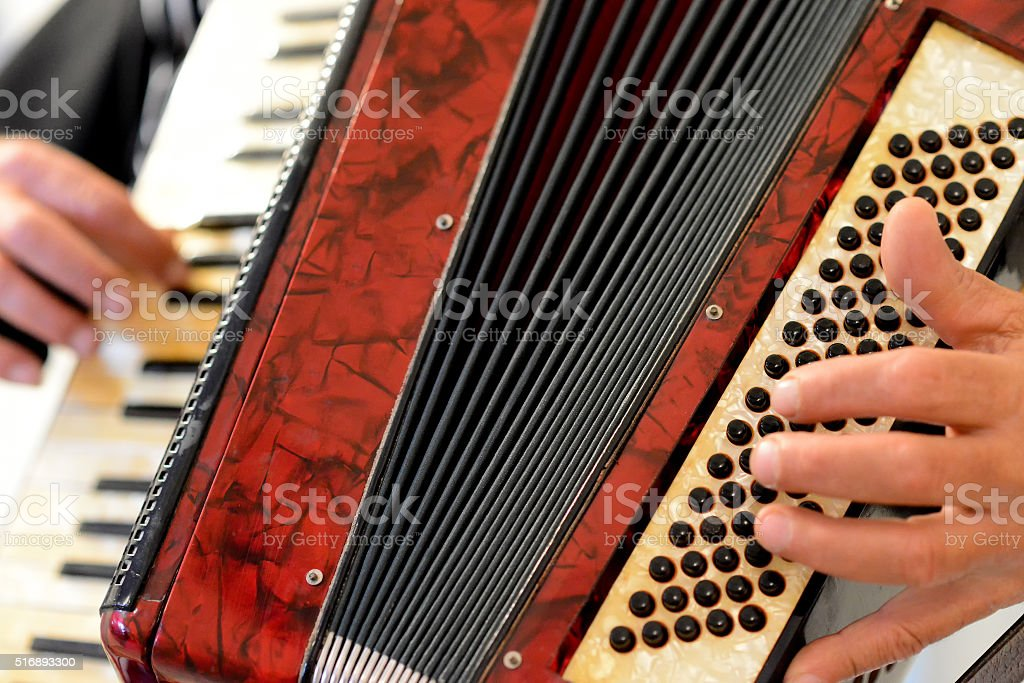Someone who plays the accordion stock photo