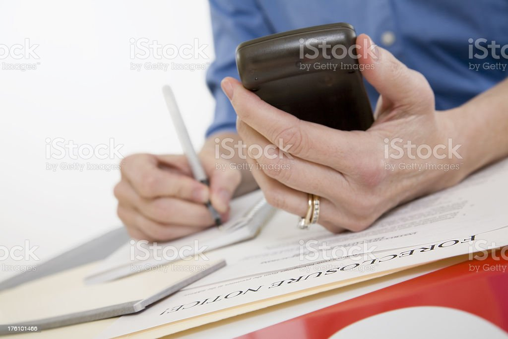 Someone Writing Trying to Prevent Foreclosure royalty-free stock photo