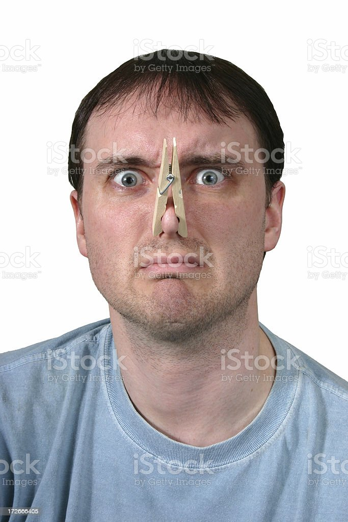Something Stinks - clothespin on nose royalty-free stock photo