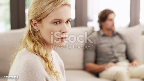 Shot of a beautiful young woman looking upset after having an argument with her husband at home