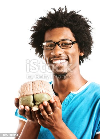 613542420 istock photo Somewhat geeky scientist smiles happily while holding model brain 185310051