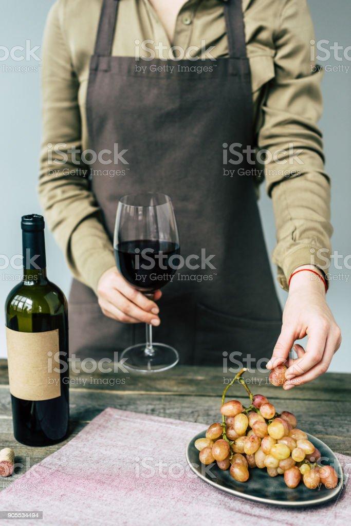 sommelier holding glass of wine stock photo