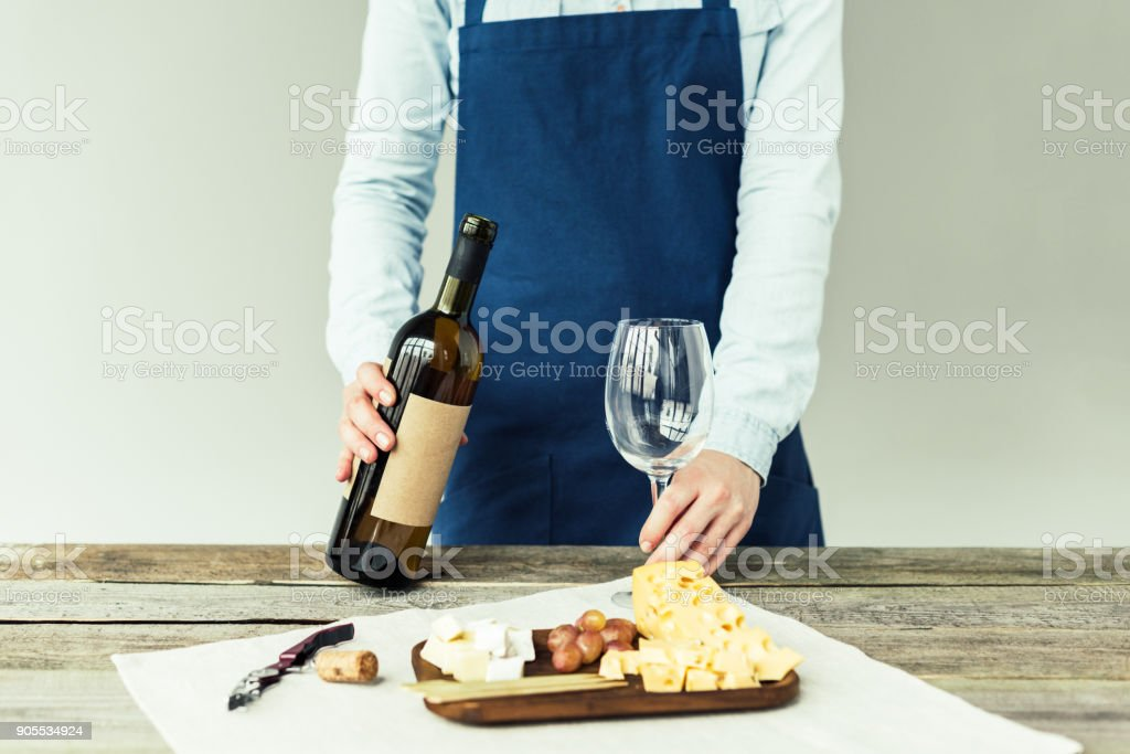 sommelier holding wine bottle and glass stock photo