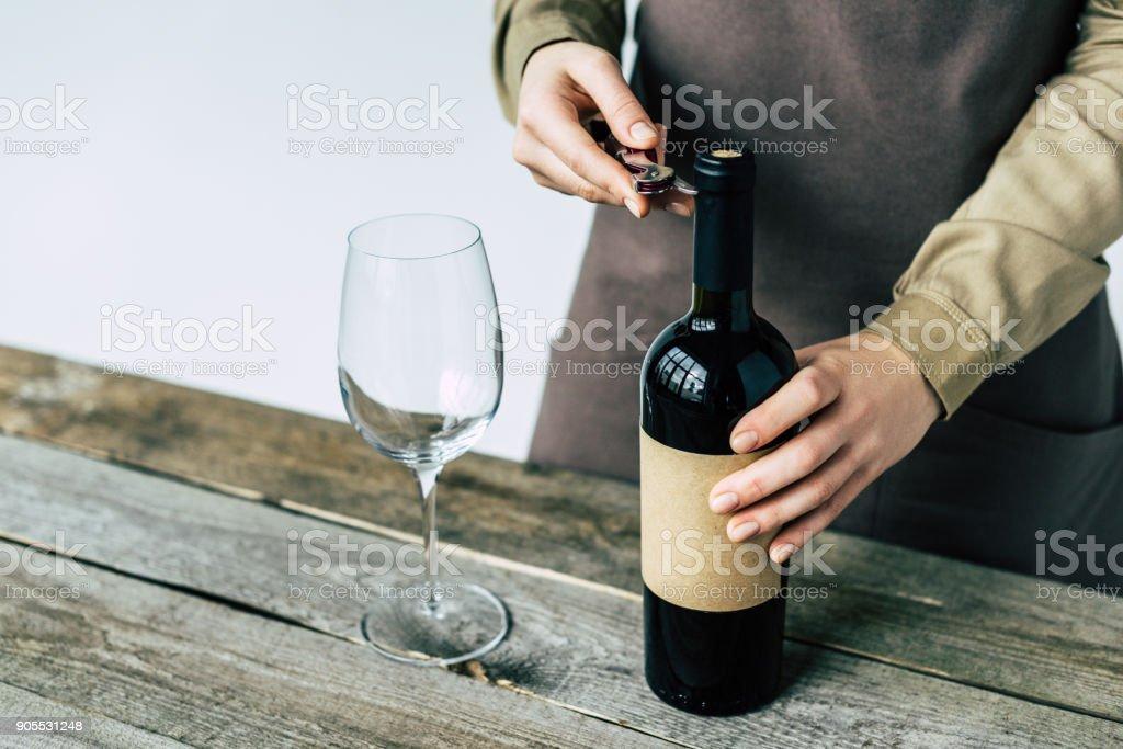 Sommelier opening bottle of wine stock photo