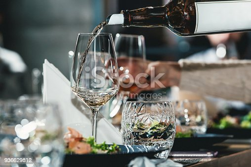 istock sommelier pouring wine into glass at wine tasting 936629812