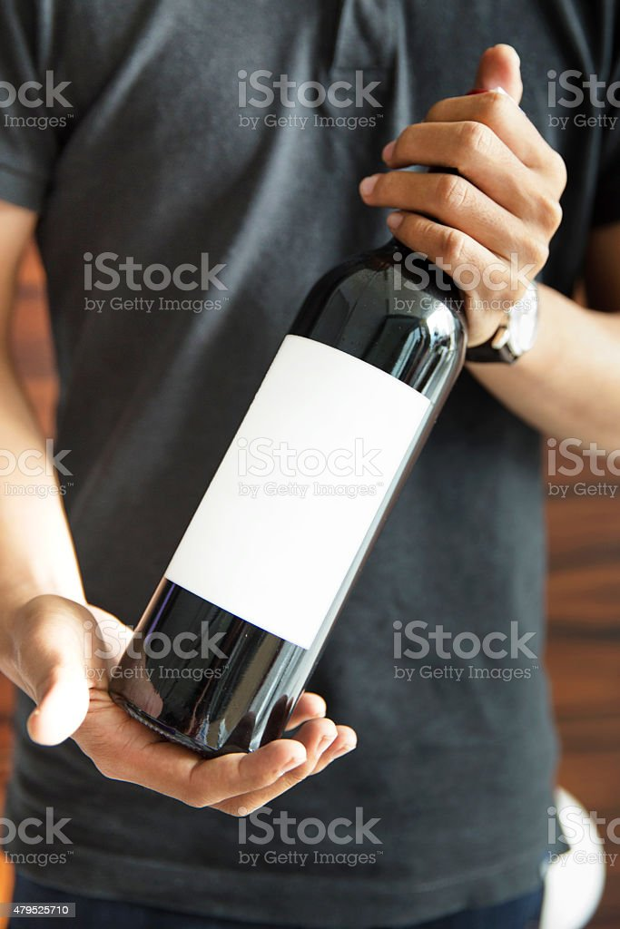 Sommelier presenting wine bottle stock photo