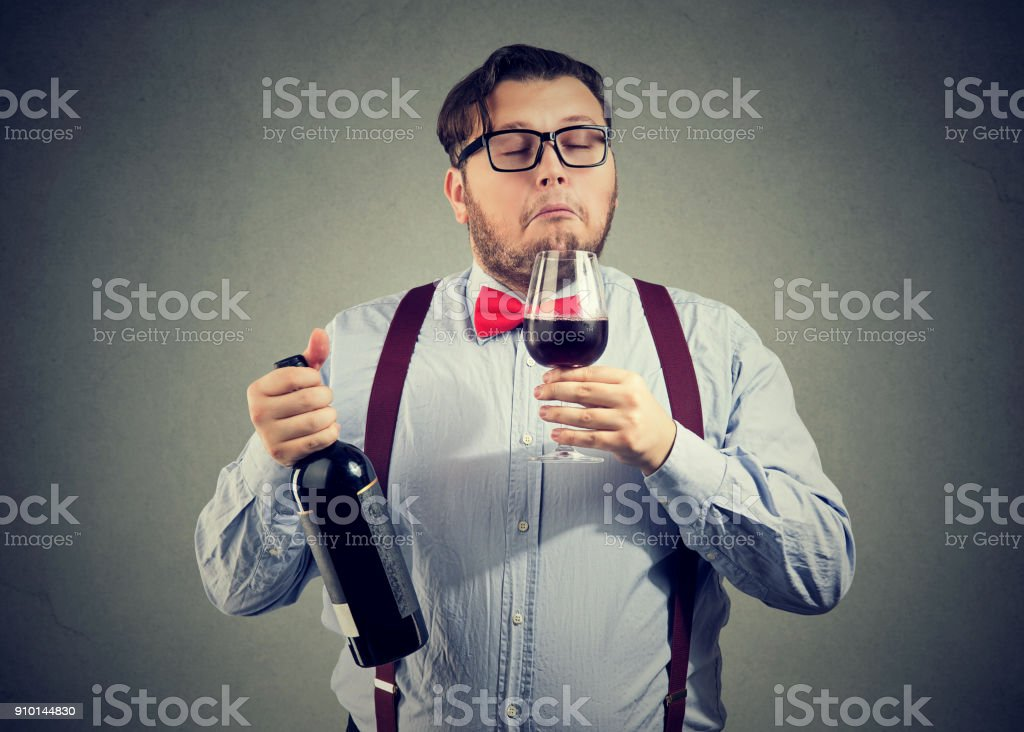 Sommelier smelling wine in glass stock photo
