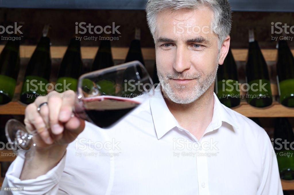 Sommelier tasting red wine. stock photo