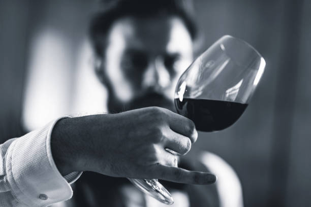 Sommelier tasting wine Sommelier tasting red wine critic stock pictures, royalty-free photos & images