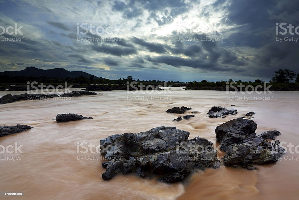 Somphamit Waterfall at sunset, Southern Laos royalty-free stock photo