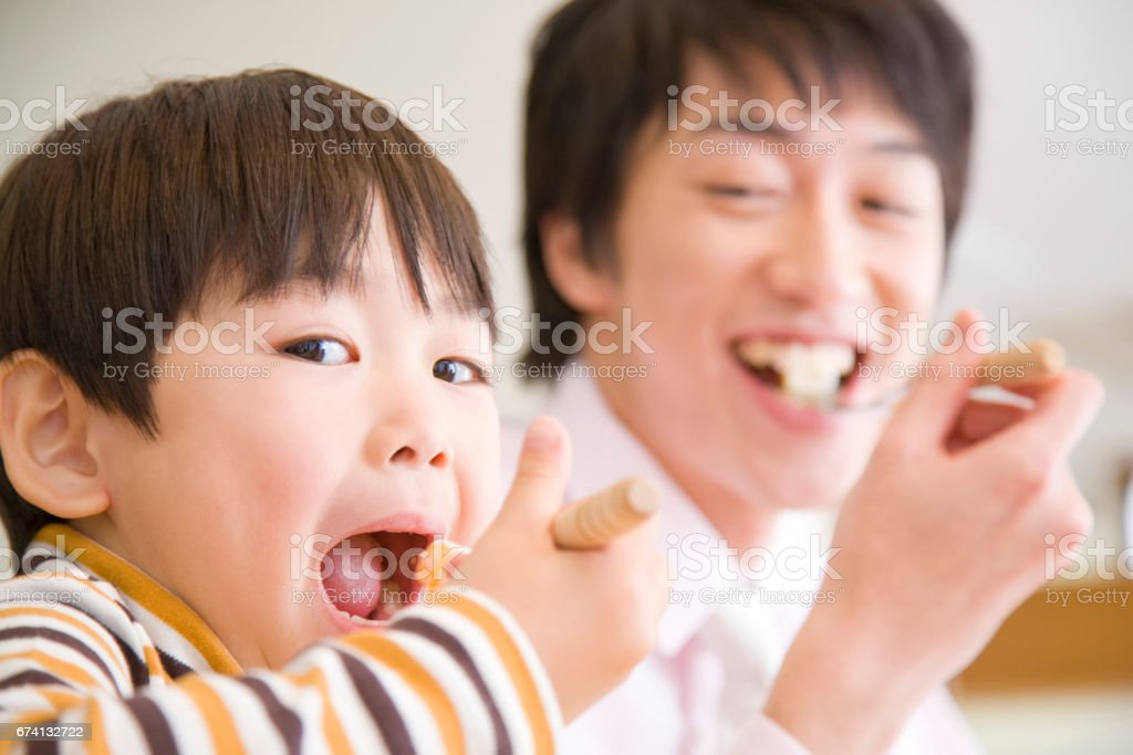 Son and dad have to eat stock photo