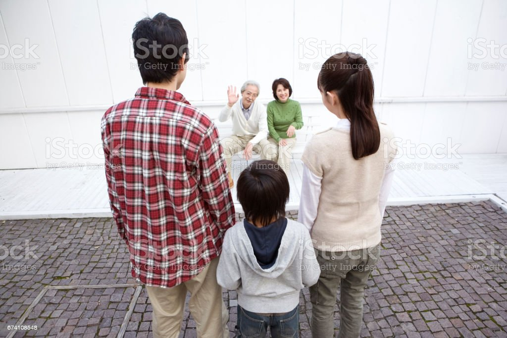 Son and his wife and grandchild waving senior couple royalty-free stock photo