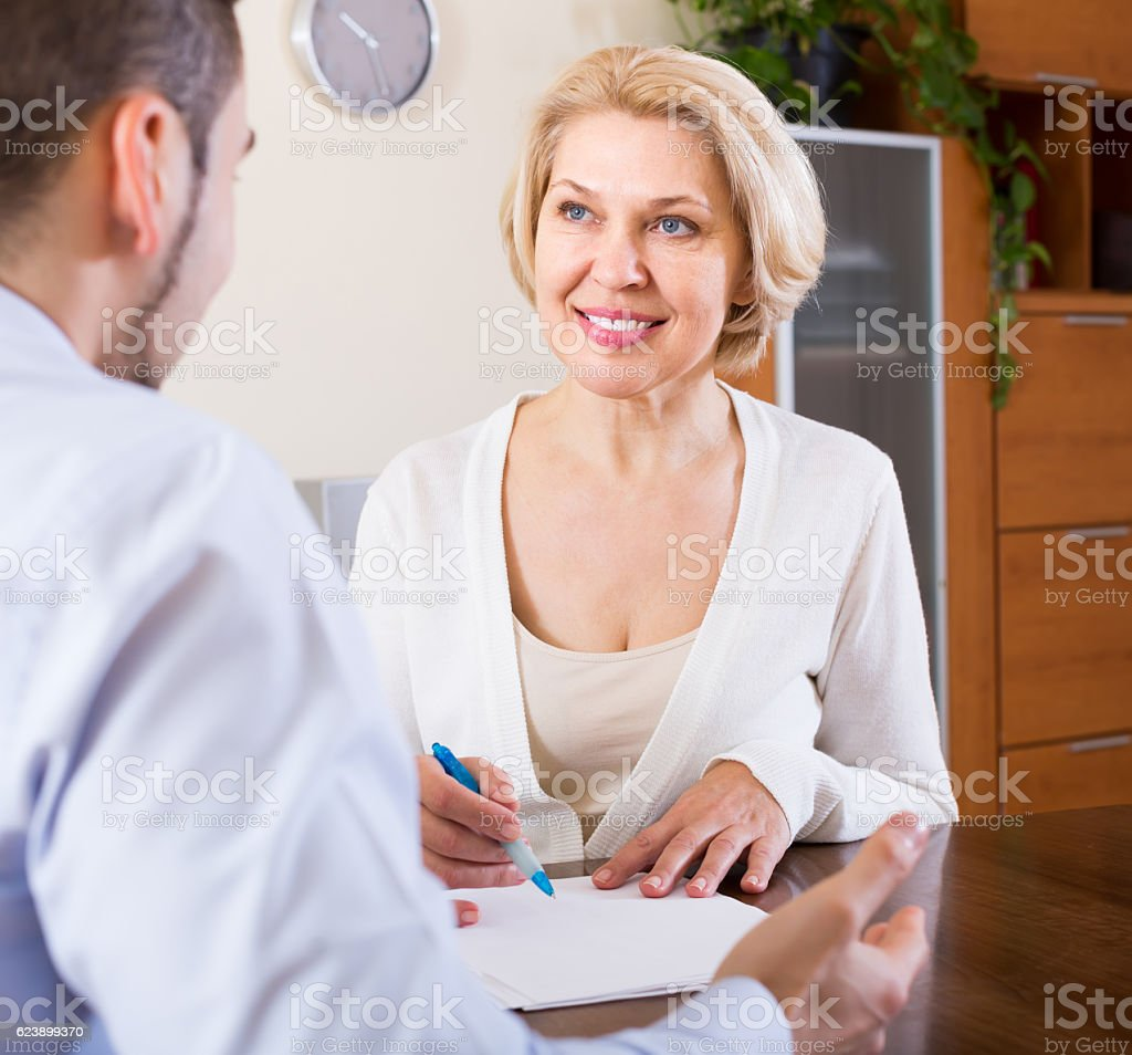 Son and senior mother with documents stock photo