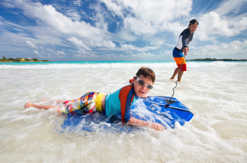 Son boogie boarding with his father