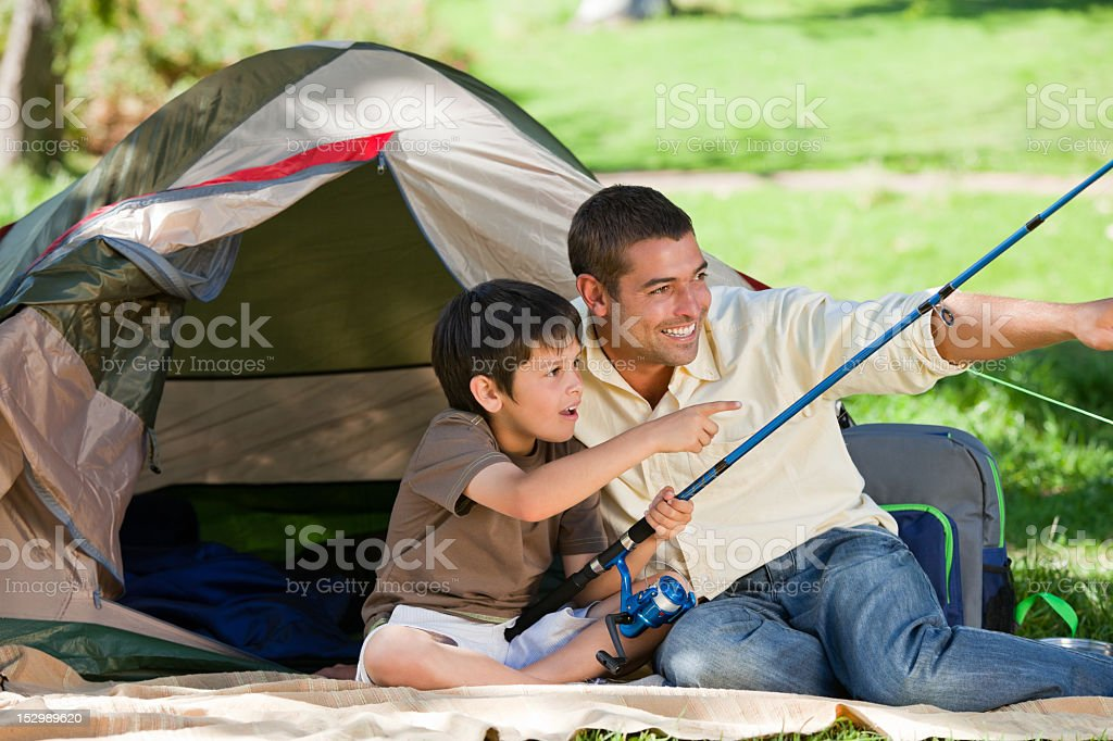 Son fishing with his father royalty-free stock photo