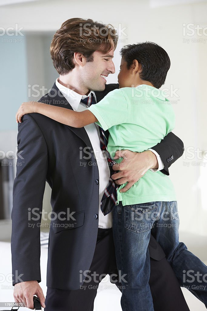 Son Greets Father On Return From Work royalty-free stock photo