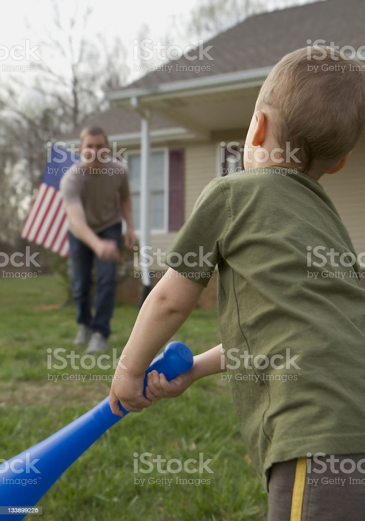Son hits dad pitch royalty-free stock photo