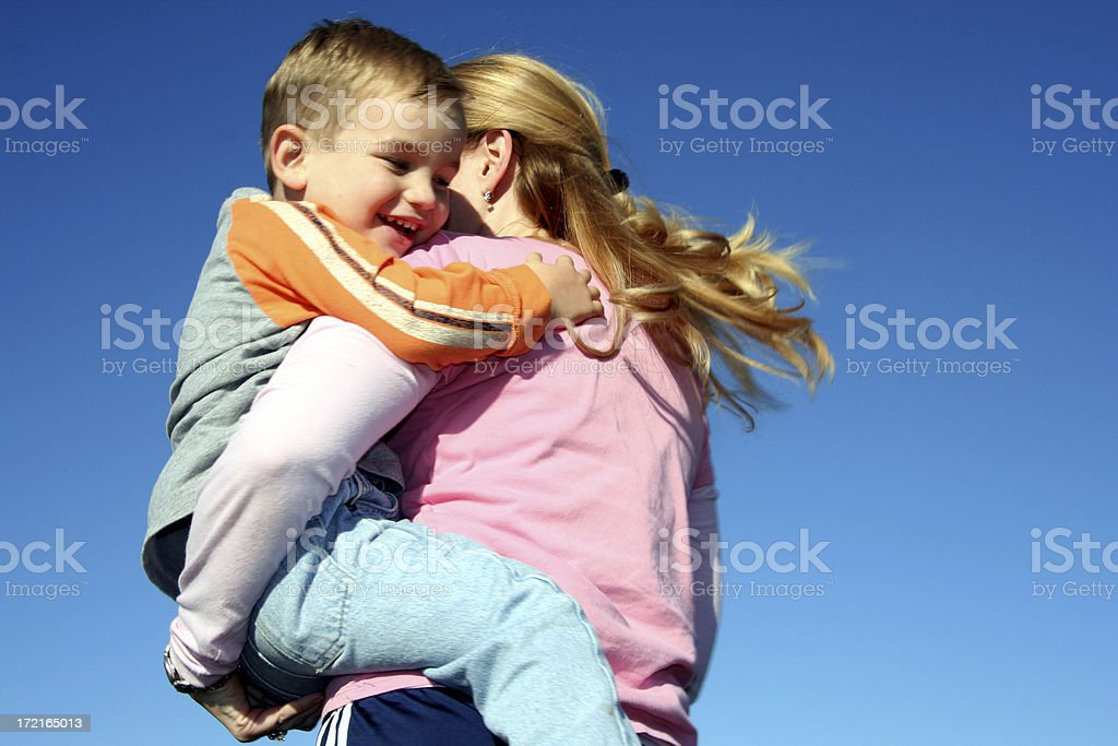 Son Holding On To Mother While Spinning Around royalty-free stock photo