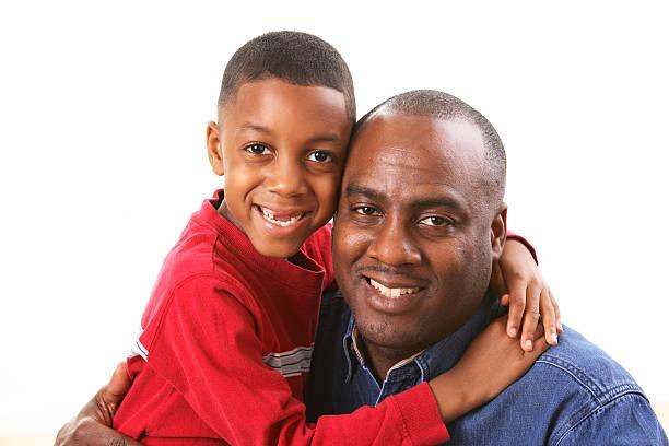 Son hugging Dad stock photo