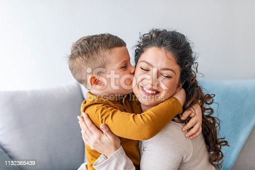 Son is kissing his mother. The kind of love that can't be described, only felt. Mom and son. Happy mother's day! Mother hugging her child