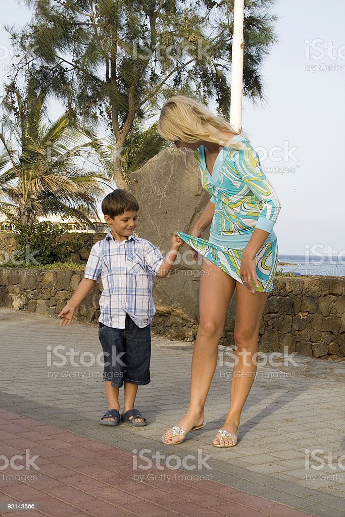 son  jokes with his mom stock photo