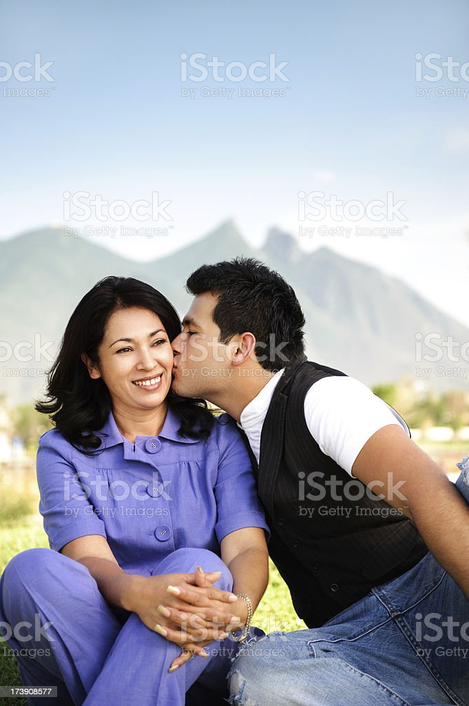 Son kissing his mother royalty-free stock photo