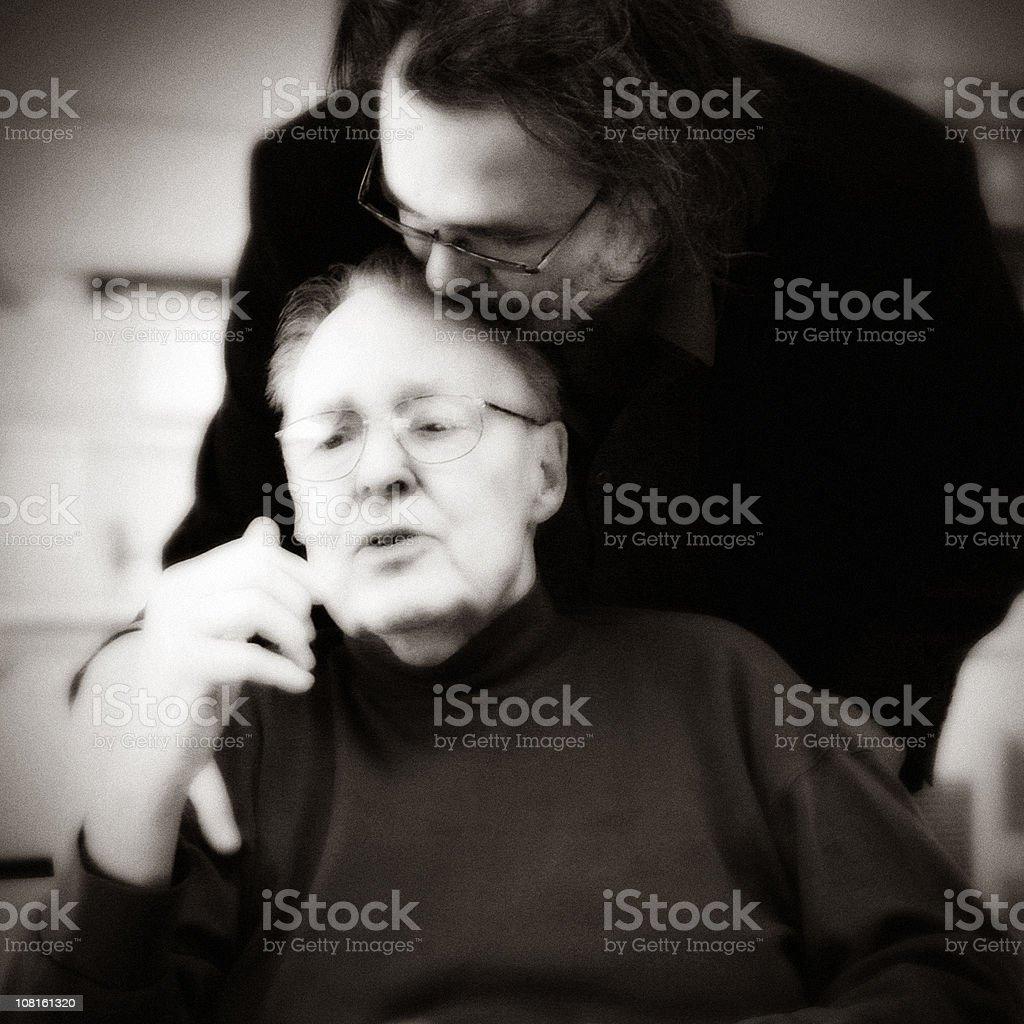 Son Kissing Senior Father on Head royalty-free stock photo