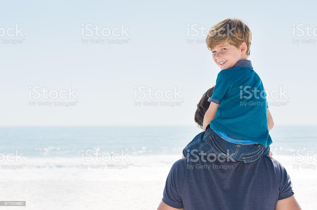 Son on piggyback stock photo