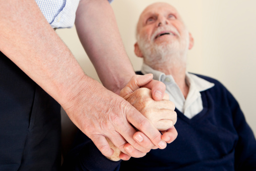 Son Patting Fathers Hand Stock Photo - Download Image Now