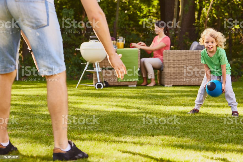 Son playing ball with father royalty-free stock photo