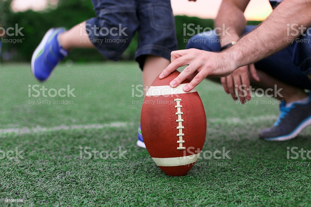 Son ready for shot rugby ball stock photo