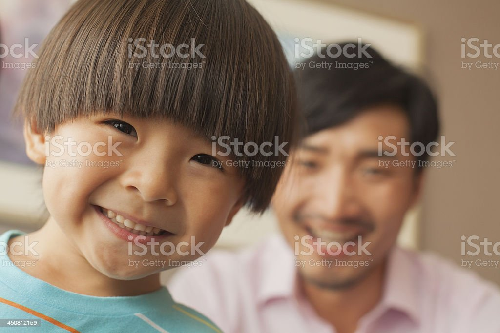 son with father smiling, portrait stock photo