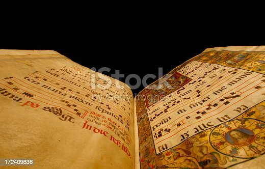 Christian 15th century song book with latin script and musical notation for music pastors