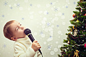 Child sings into a microphone on the New Year