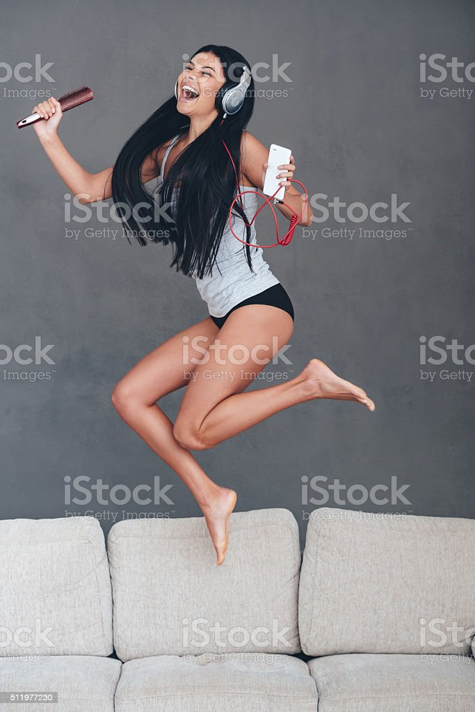Song that drives her crazy. stock photo