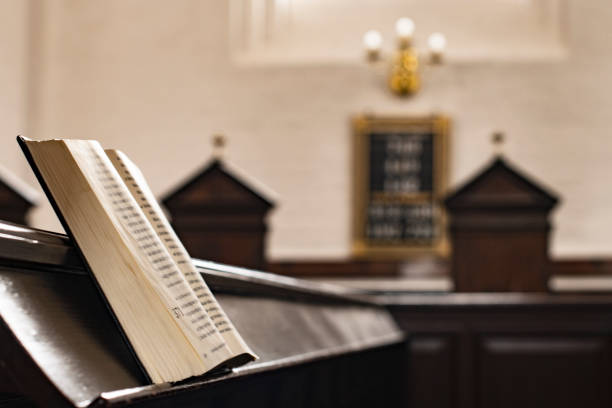 Songbook stands on the old bench in the church Songbook stands on the old bench in the church, closeup pulpit stock pictures, royalty-free photos & images