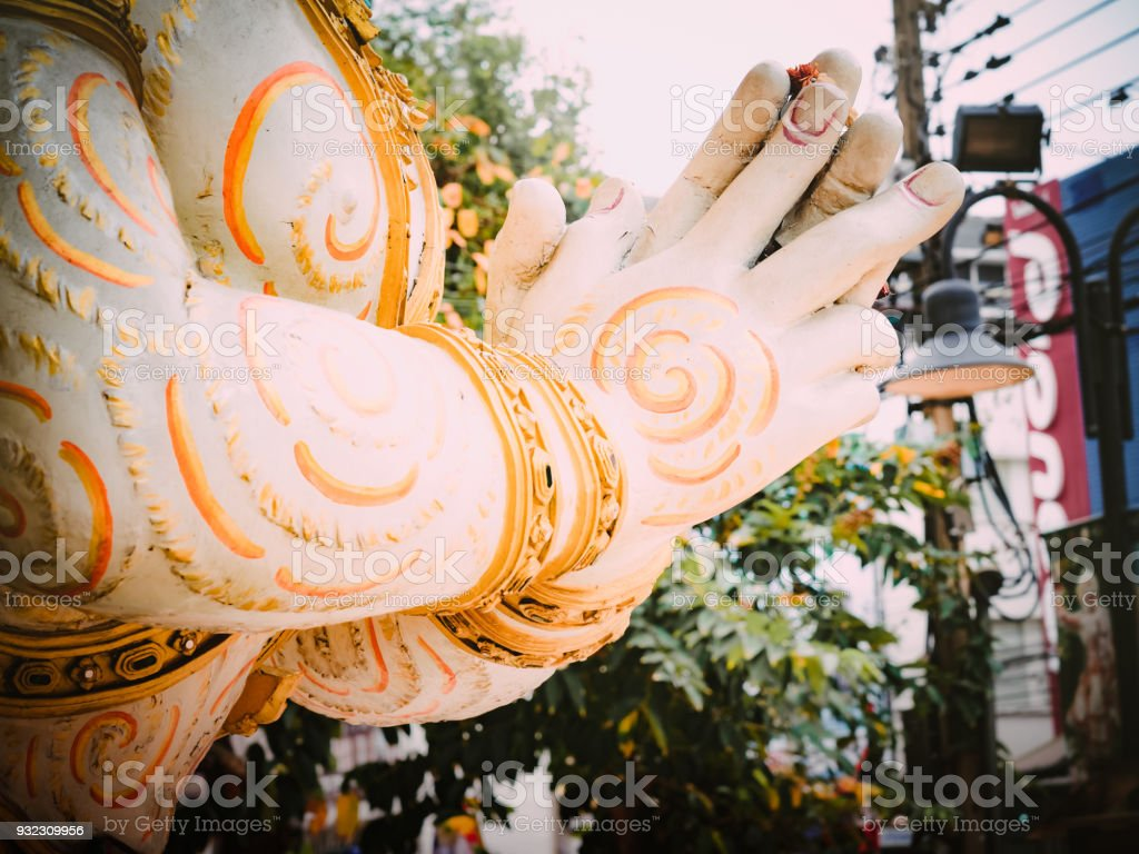 Songkran and summer at thailand concept from thai style statue with hello(sawasdee) signal in bangkok with soft focus background stock photo