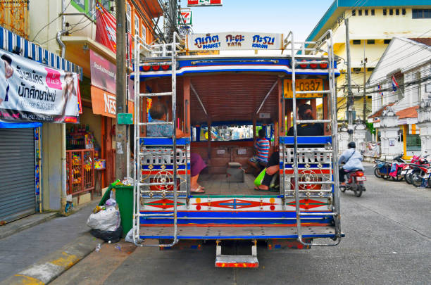 Songthaew parked at Ranong Road in Phuket Town stock photo