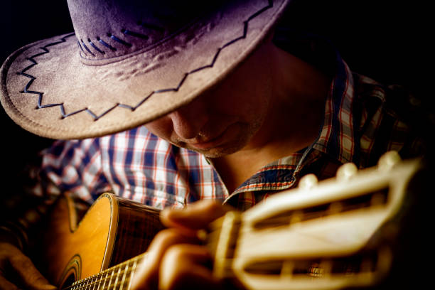 Songwriter and Guitar Player Songwriter and Guitar Player country and western music stock pictures, royalty-free photos & images
