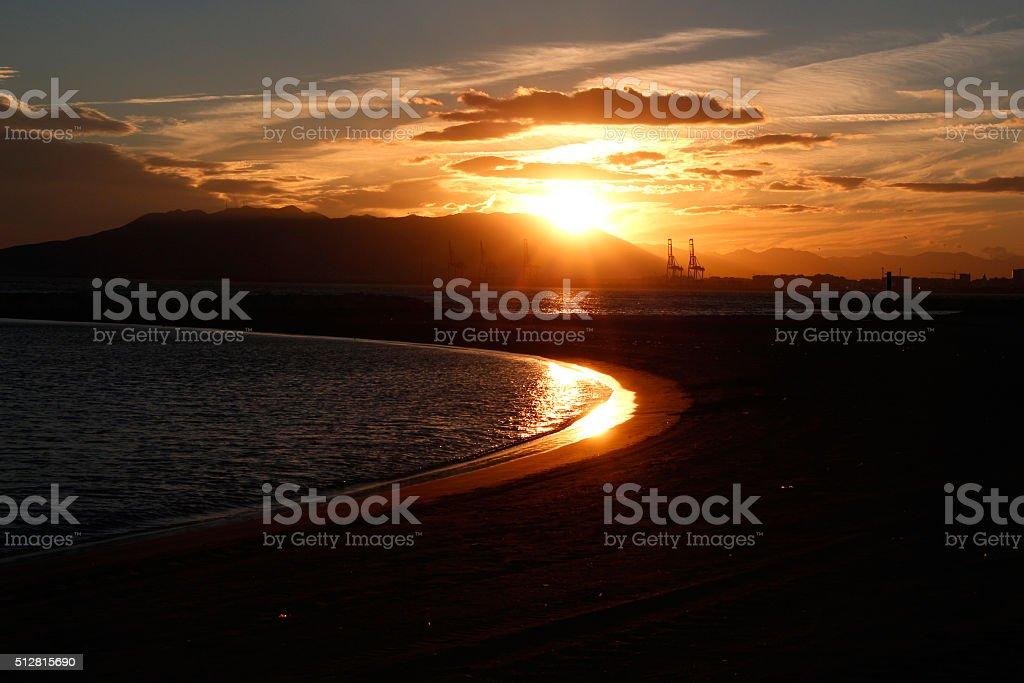 Sonneunterang über Hafen von Malaga stock photo