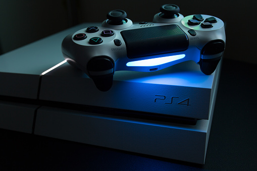 Sony Play Station 4 And Dualshock Video Game Console Stock Photo - Download Image Now