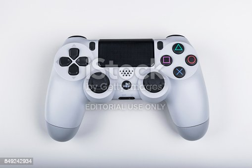 istock Sony PlayStation 4 game console with a joystick dualshock 4,  home video game console developed by Sony Interactive Entertainment. 849242934