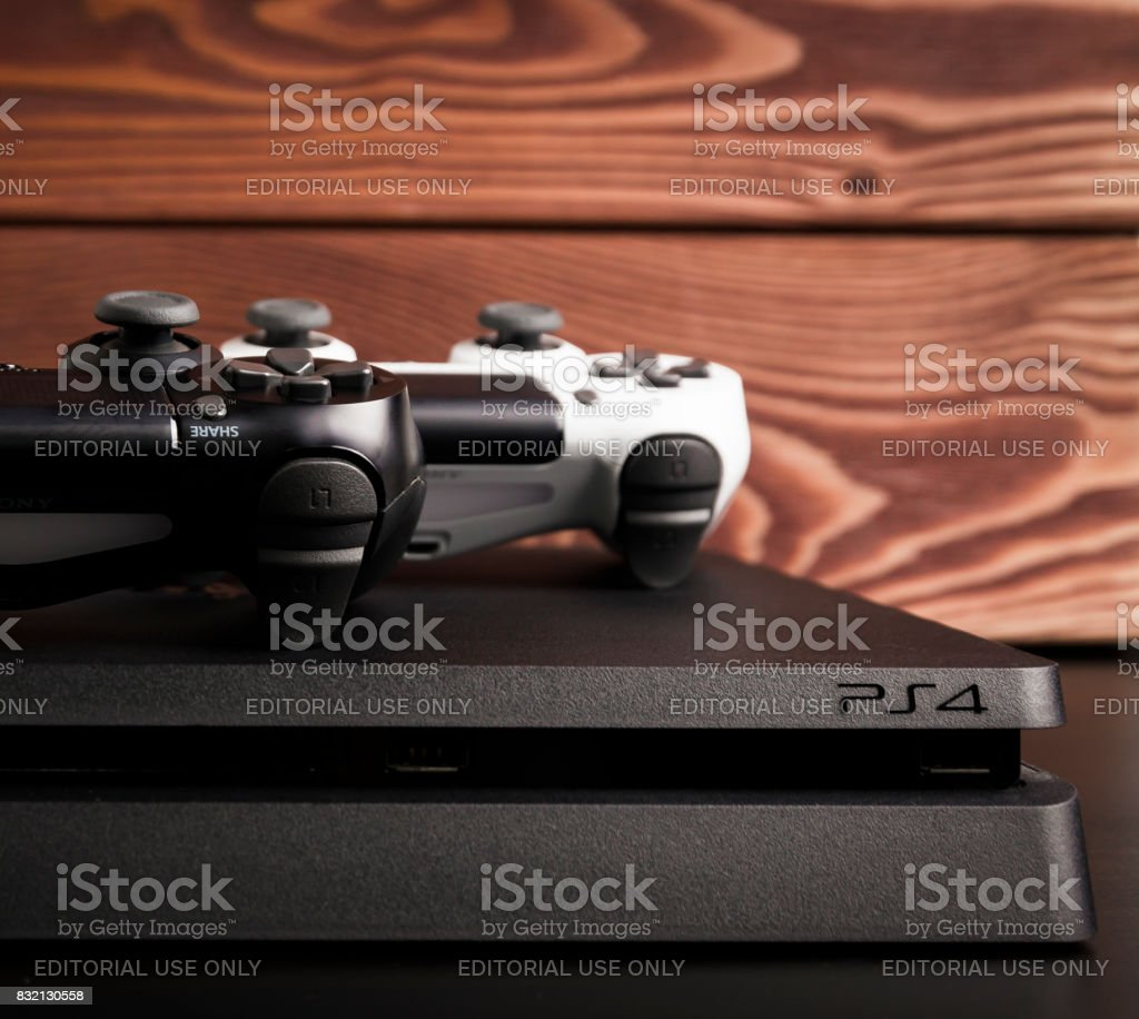 Sony PlayStation 4 Slim 1Tb revision and game controller stock photo