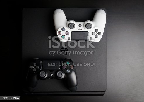 istock Sony PlayStation 4 Slim 1Tb revision and game controller 832130564