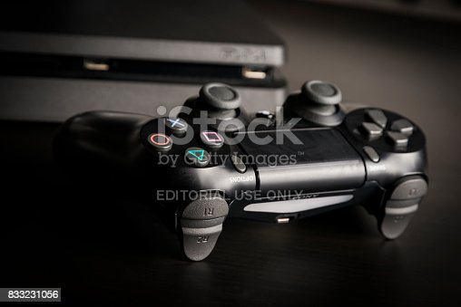 istock Sony PlayStation 4 Slim 1Tb revision and game controller 833231056