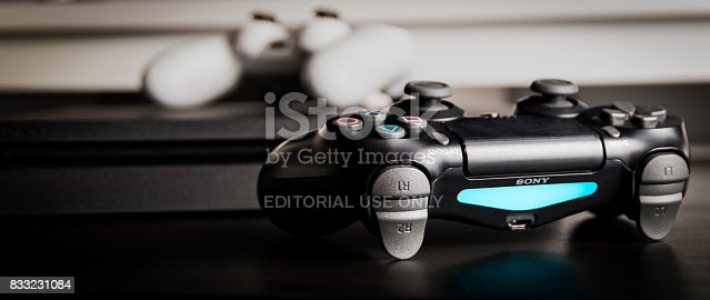 istock Sony PlayStation 4 Slim 1Tb revision and game controller 833231084
