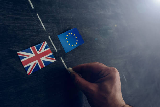 Soon there will be a border between European Union and England Hand drawing with chalk on blackboard a line to separate the Great Britain flag from the EU. Brexit concept between stock pictures, royalty-free photos & images
