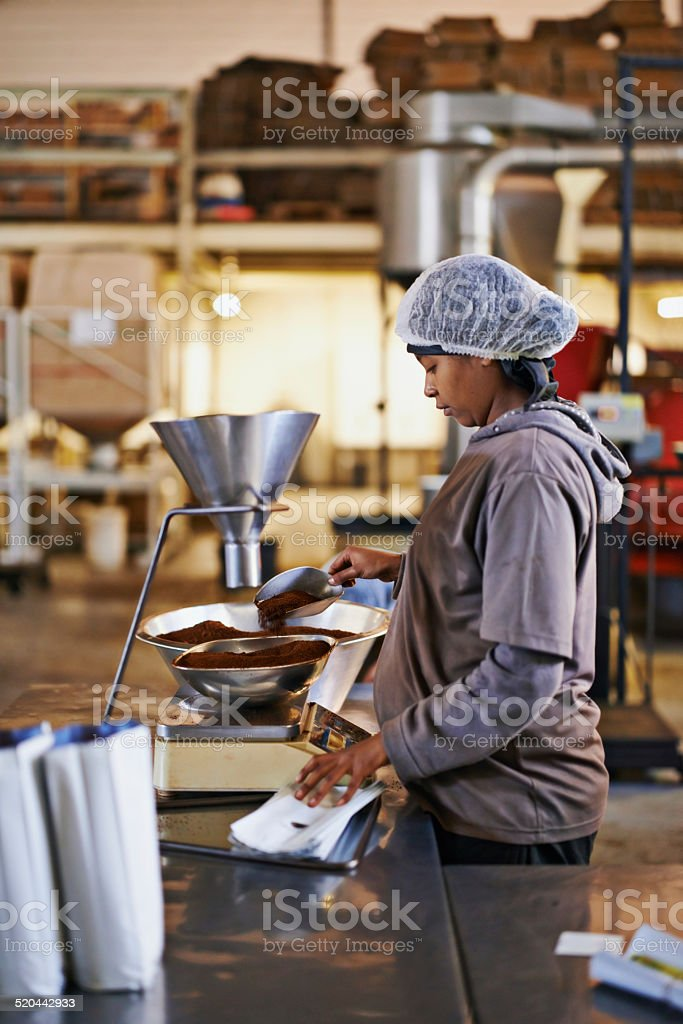Soon to be in your cup from the production floor stock photo
